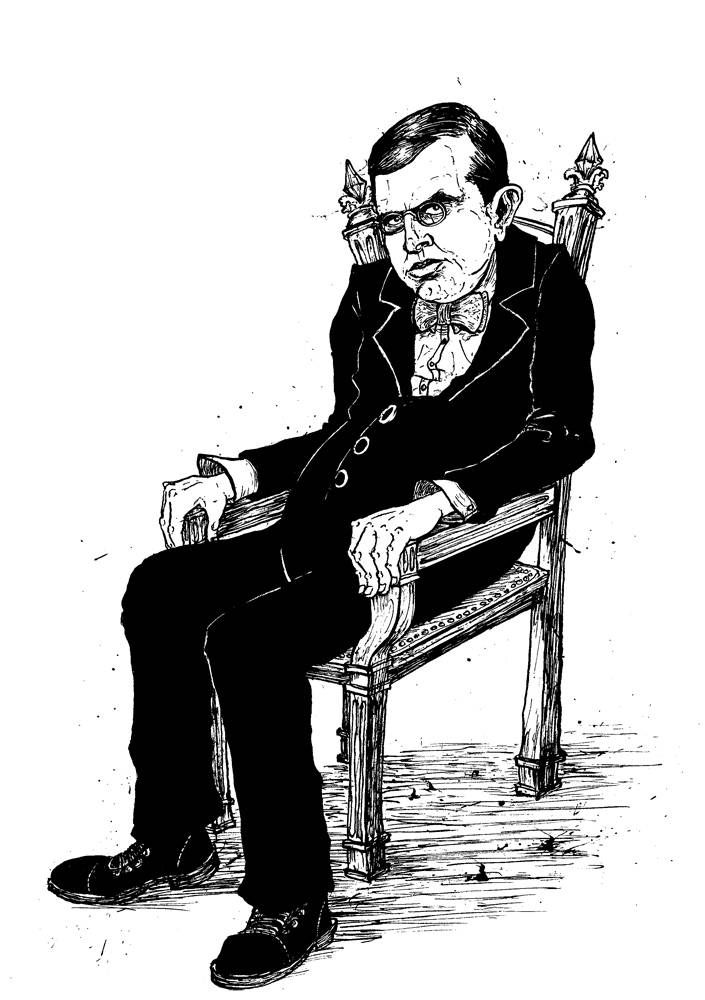 American Author Theodore Dreiser sitting in a chair